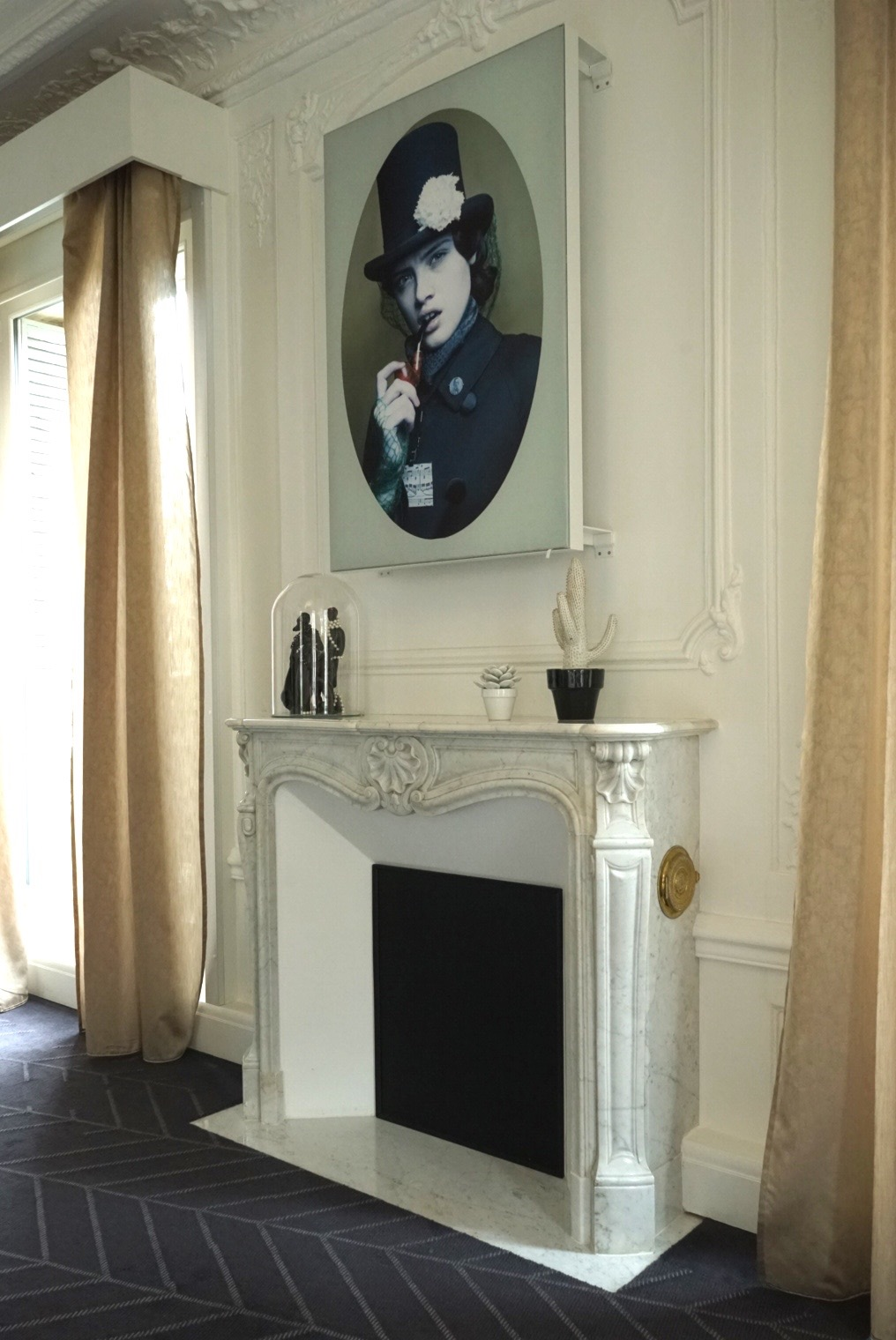W Paris ~ A cloche covering a figurine sits on the mantel in this hotel room