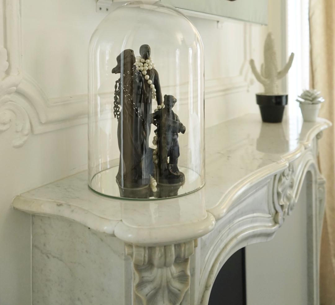 W Paris ~ Close up of cloche covering a figurine