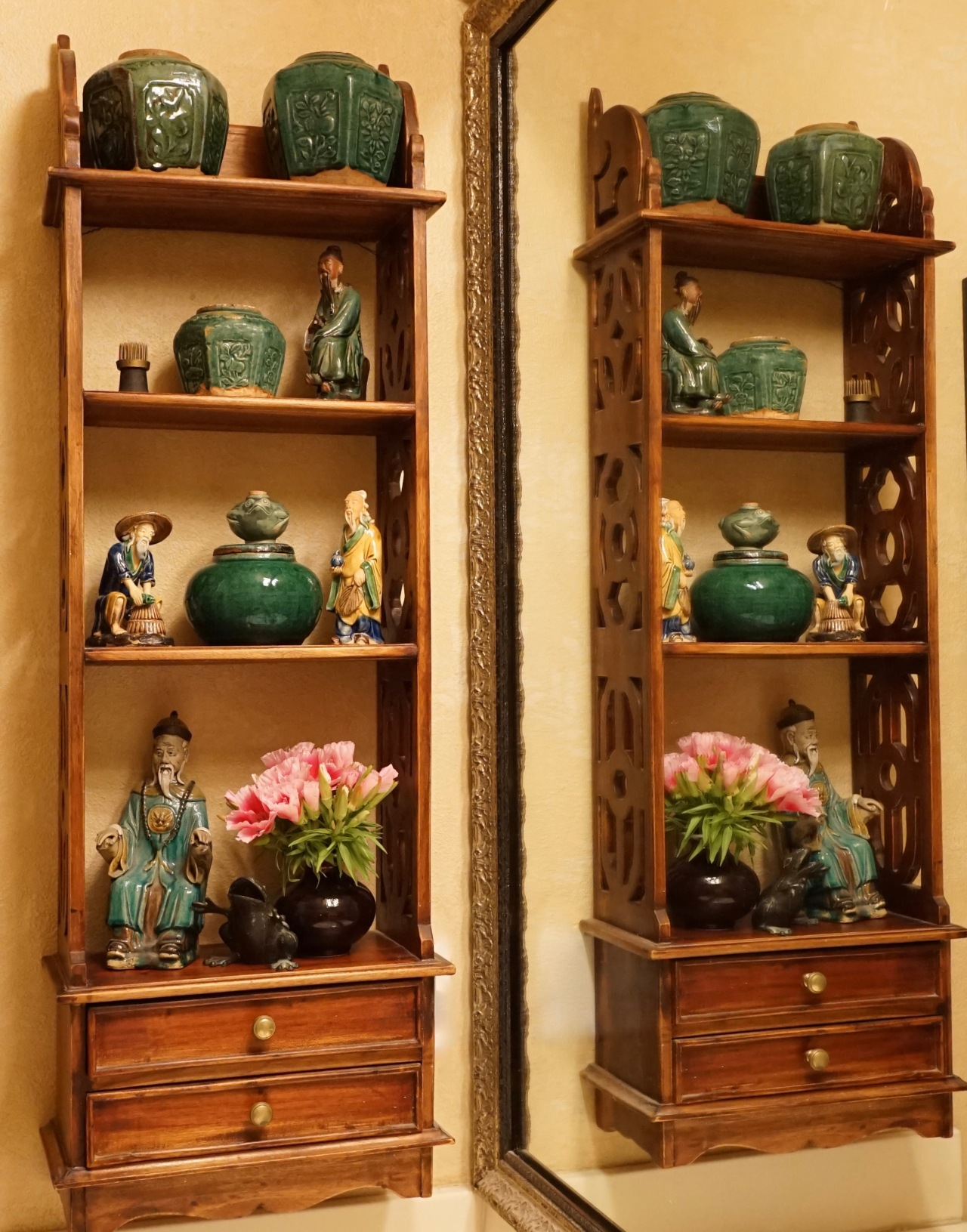 Collection of Asian pottery and figurines displayed