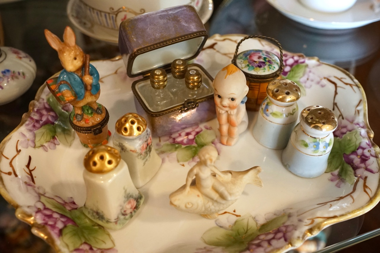 Collection of miniature porcelain trinkets grouped together